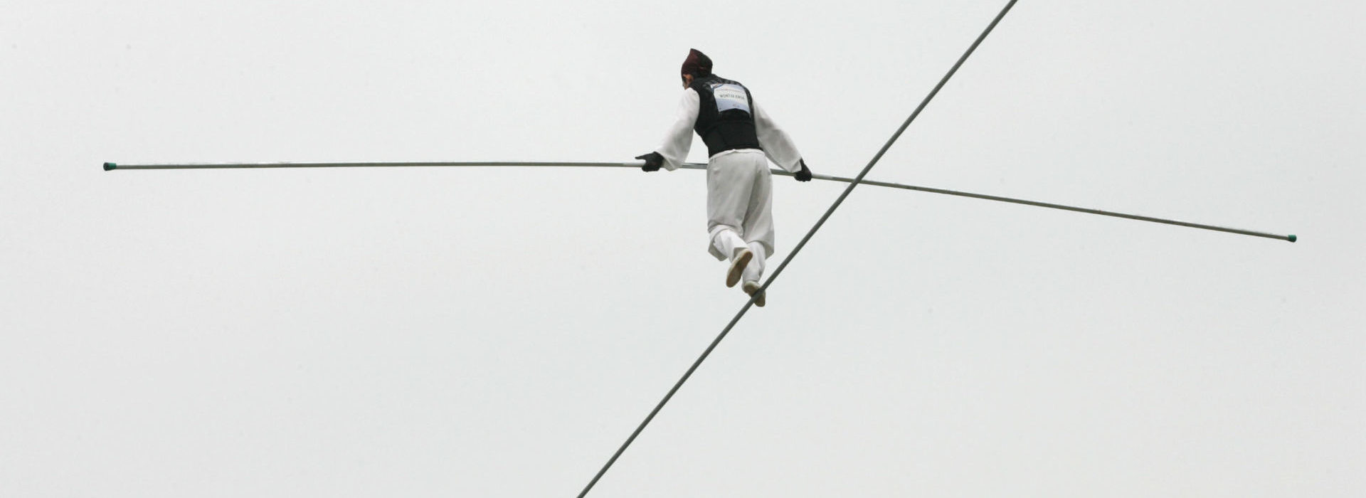 SEOUL, SOUTH KOREA - MAY 3:  Kwon Won-Tae of South Korea participates in the first World High Wire Championships, over the HanGang River, on May 3, 2007 in Seoul, South Korea. As part of the Hi Seoul Festival 2007 programme, 18 world famous high-wire walkers from the Americas, Europe and Asia will compete in the championships in which contestants have to negotiate a 30mm-thick iron wire stretching 1,000m across the HanGang River in the fastest possible time.  (Photo by Chung Sung-Jun/Getty Images)